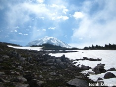 View of Mt. Rainier next to giant snow field